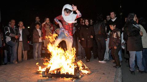 ap_iran_fire_festival_jumping_thru_flames_ss_thg_120314_wblog