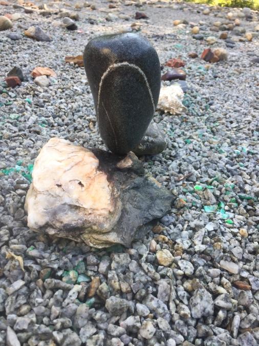 Dark face stone balance