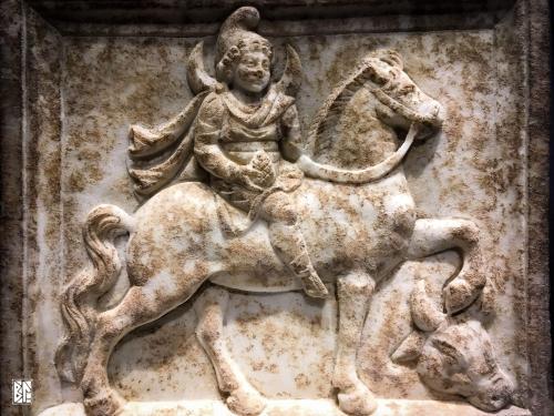 Mên on horseback bas relief BL
