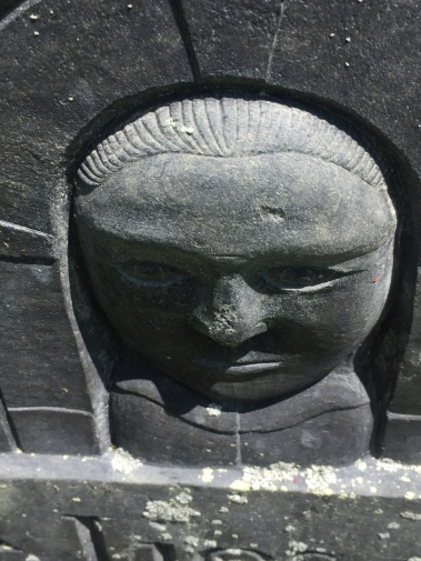 gravestone face