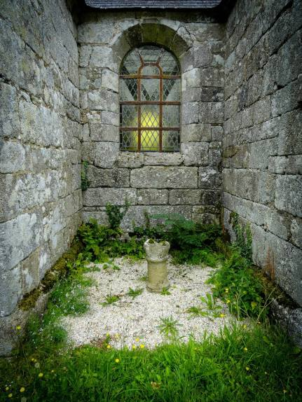 chapel with font and buttercups